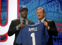 CHICAGO, IL - APRIL 28:  (L-R) Eli Apple of Ohio State holds up a jersey with NFL Commissioner Roger Goodell after being picked #10 overall by the New York Giants during the first round of the 2016 NFL Draft at the Auditorium Theatre of Roosevelt University on April 28, 2016 in Chicago, Illinois.  (Photo by Jon Durr/Getty Images) ORG XMIT: 609385781