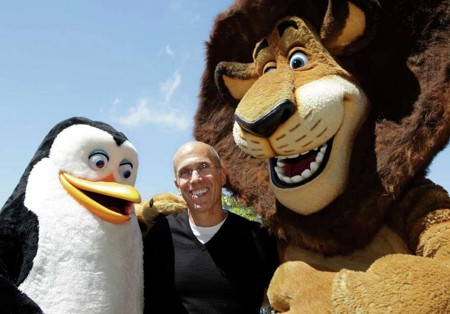 "Kowalski the penguin and Alex the lion, from ""Madagascar,"" dwarf DreamWorks Animation CEO Jeffrey Katzenberg. Comcast, which is buying DreamWorks Animation, says the takeover is subject to an antitrust review by the Department of Justice or the Federal Trade Commission. Photo: Paul Sakuma, STF / AP2012"