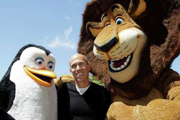 "Kowalski the penguin and Alex the lion, from ""Madagascar,"" dwarf DreamWorks Animation CEO Jeffrey Katzenberg. Comcast, which is buying DreamWorks Animation, says the takeover is subject to an antitrust review by the Department of Justice or the Federal Trade Commission."