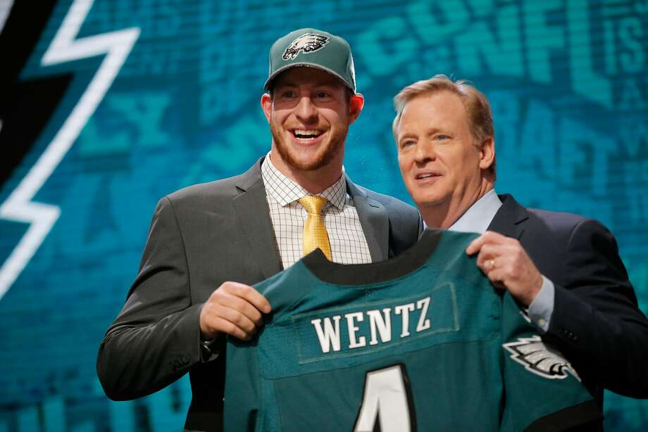 CHICAGO, IL - APRIL 28:  (L-R) Carson Wentz of the North Dakota State Bison holds up a jersey with NFL Commissioner Roger Goodell after being picked #2 overall by the Philadelphia Eagles during the first round of the 2016 NFL Draft at the Auditorium Theatre of Roosevelt University on April 28, 2016 in Chicago, Illinois.  (Photo by Jon Durr/Getty Images) Photo: Jon Durr, Getty Images