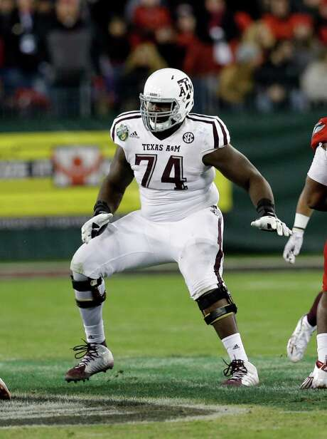 Offensive lineman Germain Ifedi is the first first-rounder from Texas A&M to not only play for coach Kevin Sumlin but also to have been recruited by him. Photo: Mark Humphrey, STF / AP