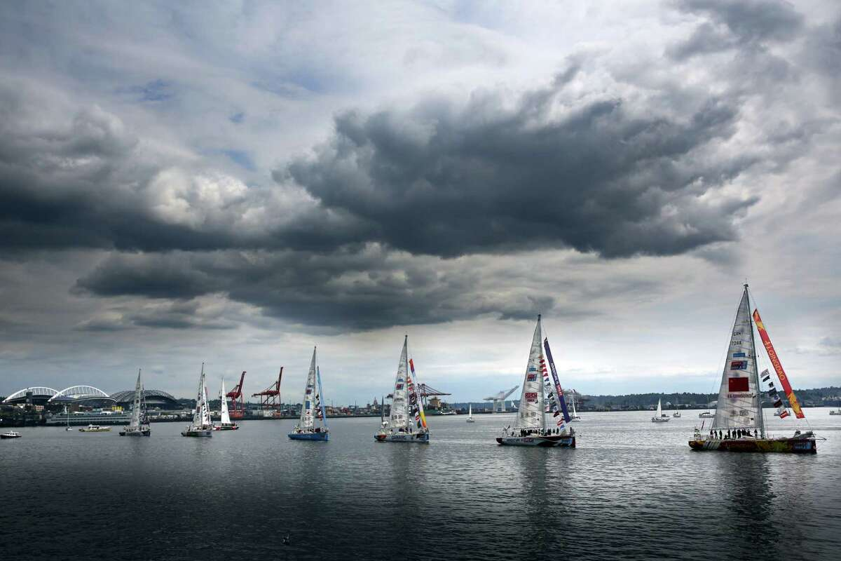 Yachts participating in the Clipper Round the World race parade along the Elliott Bay waterfront as a part of departing festivities, Thursday, April 28, 2016. The 12 crews are racing around the world in 11 months; they depart from Seattle to Panama and then New York. The crews represent 44 different nationalities and range in age from 18 to 74.