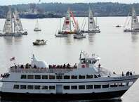 Spectators watch from an Argosy Cruise ship as yachts participating in the Clipper Round the World race parade along the waterfront, Thursday, April 28, 2016.  The 12 crews are racing around the world in 11 months; they depart from Seattle to Panama and then New York.