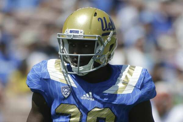 UCLA linebacker Myles Jack stands on the field during the first half of an NCAA college football game against Virginia at Rose Bowl, Saturday, Sept. 5, 2015, in Pasadena, Calif. (AP Photo/Jae C. Hong)
