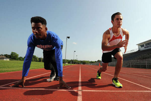 West Brook's Julian Perez, right, runs the 1,600- and 3,200-meter and Jeffery Hulon Jr. runs the 100- and 200-meter. The two will be competing for a spot at the state track meet in Austin. Photo taken Wednesday, April 28, 2016 Guiseppe Barranco/The Enterprise