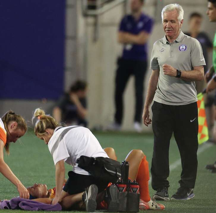 Dash midfielder Carli Lloyd, on the ground, suffered a right knee injury last week and will miss at least six weeks.