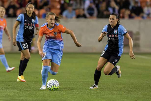 Dash midfielder Andressa Machary (17) breaks away from Red Stars defenders near mid field in a National Women's Soccer League game at BBVA Compass Stadium on Saturday, April 16, 2016, in Houston.