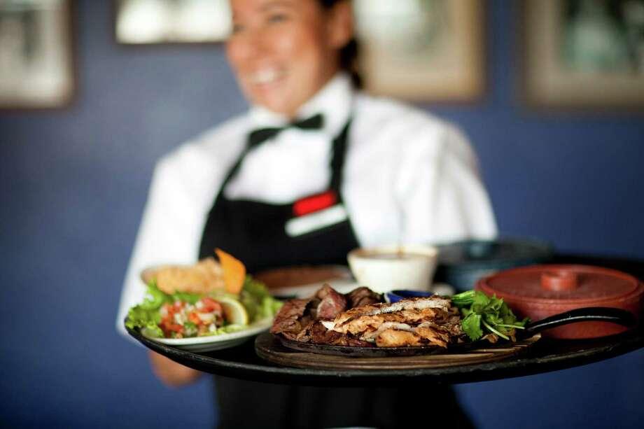 Server at Molina's Cantina, Washington location. Photo: Julie Soefer / handout
