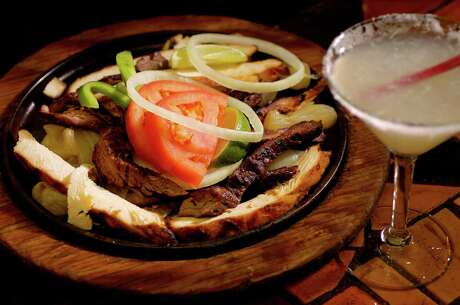 A Fajita combo waits to be eaten while at Spanish Village off Almeda, Friday, January 16, 2004 in Houston.  (Christobal Perez/Houston Chronicle)     HOUCHRON CAPTION (04/22/2004):  The fajita combo from Spanish Village on Almeda shows why the family-run restaurant is a Tex-Mex favorite.  And don't miss the fresh-lime margaritas served in martini glasses.
