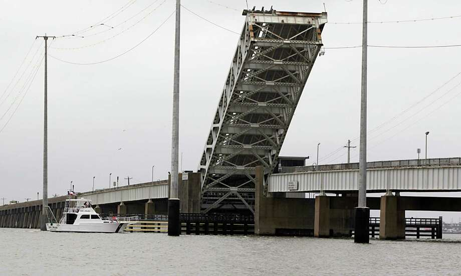 Texas A&M Galveston's R/V Earl L. Milan passes under the draw bridge on the Pelican Island Causeway which connects Galveston to Pelican Island Thursday, April 28, 2016, in Galveston. ( James Nielsen / Houston Chronicle ) Photo: James Nielsen, Staff / © 2016  Houston Chronicle