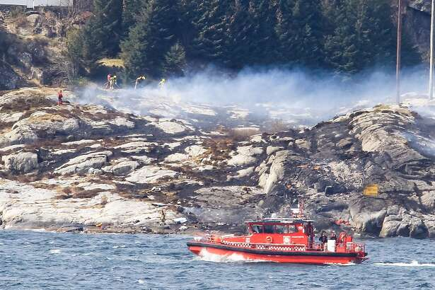 Rescue forces work at the shore west of Bergen, Norway after a helicopter transporting 13 workers from an offshore oil field in the North Sea crashed off on April 29, 2016.   / AFP PHOTO / NTB scanpix AND NTB Scanpix / Rune Nielsen / Norway OUTRUNE NIELSEN/AFP/Getty Images