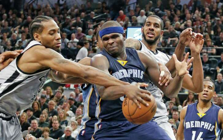 Kawhi Leonard of the Spurs tries to strip Zach Randolph of the Memphis Grizzlies of the ball in Game 1 of the Western Conference quarterfinals at the AT&T Center on April 17, 2016 in San Antonio.