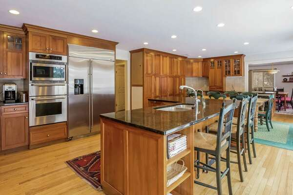 The kitchen has granite counters, a center island and eat-in area.