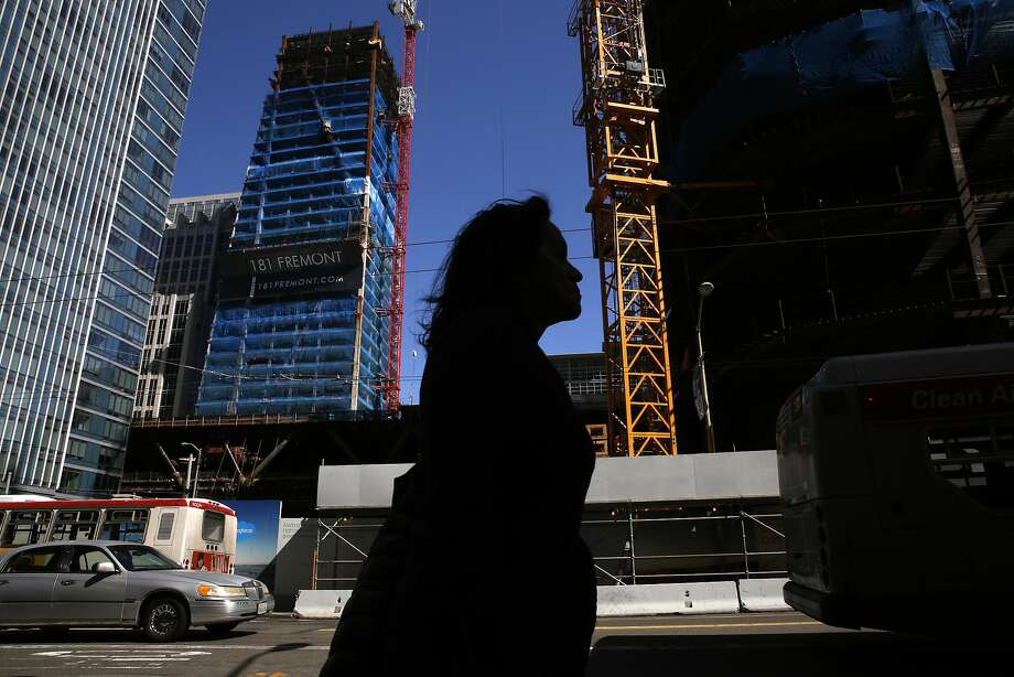 Pedestrians walk past the construction site of Salesforce Tower April 28, 2016 in San Francisco, Calif. Photo: Leah Millis, The Chronicle