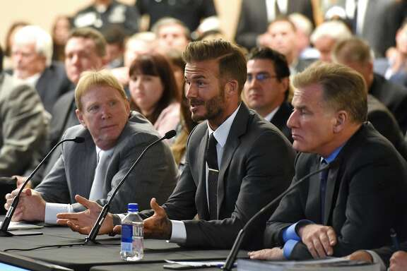 LAS VEGAS, NV - APRIL 28:  (L-R) Oakland Raiders owner Mark Davis, former soccer player David Beckham and Las Vegas Sands Corp. President and Chief Operating Officer Robert Goldstein attend a Southern Nevada Tourism Infrastructure Committee meeting at UNLV on April 28, 2016 in Las Vegas, Nevada. Davis told the committee he is willing to spend USD 500,000 as part of a deal to move the team to Las Vegas if a proposed USD 1.3 billion, 65,000-seat domed stadium is built by casino magnate Sheldon Adelson's Las Vegas Sands Corp. and real estate agency Majestic Realty, possibly on a vacant 42-acre lot a few blocks east of the Las Vegas Strip recently purchased by UNLV.  (Photo by Ethan Miller/Getty Images)