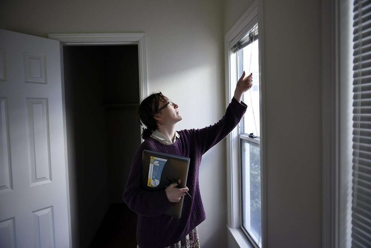 Elysseé Wilson-Egolf checks on an empty apartment as part of her duties as a resident manager of a dorm-style apartment building in Berkeley.