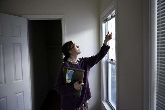 Elysse Wilson-Egolf checks on an empty apartment as part of her duties as a resident manager of a dorm style apartment building in Berkeley, CA Thursday, April 28, 2016.