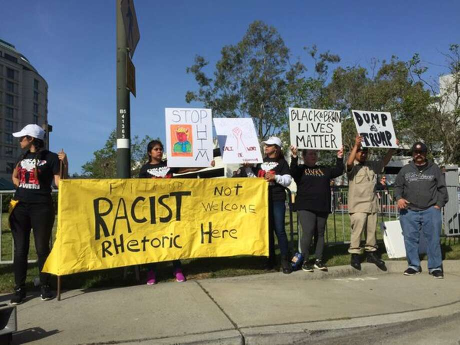 Protesters gather outside the California Republican Convention in Burlingame Friday, April 29, 2016.