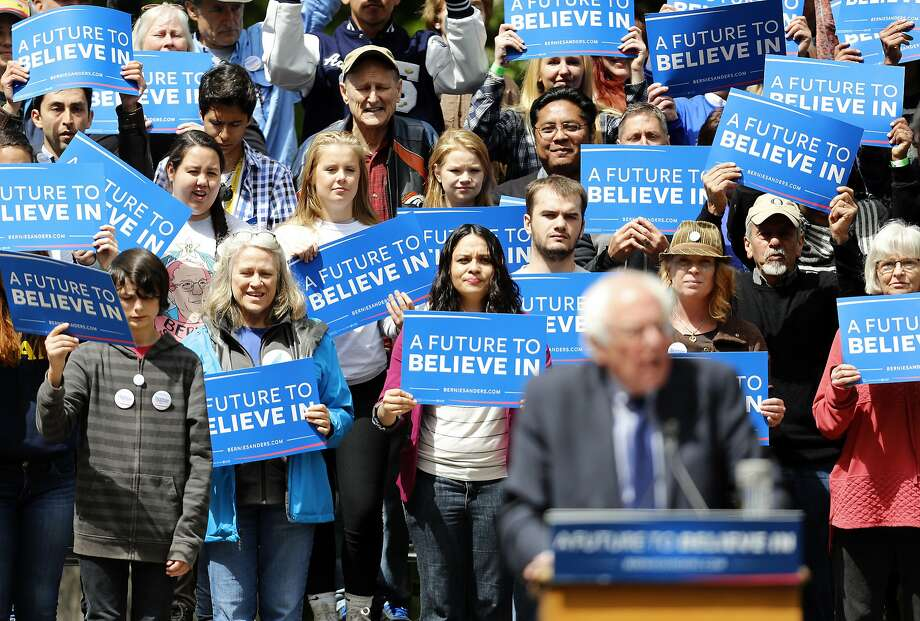 Audience members listen as Democratic presidential candidate, Sen. Bernie Sanders, I-Vt., speaks during a rally in Springfield, Ore., Thursday, April 28, 2016. (AP Photo/Ryan Kang) Photo: Ryan Kang, Associated Press