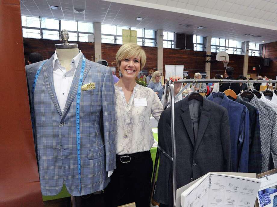 """Independent Personal Stylist, Nancy Carr, with J. Hilburn Custom Menswear during the Greenwich Chamber of Commerce Business & Culinary Showcase at the Civic Center in Old Greenwich, Conn., Thursday night, April 28, 2016. The event is billed as the """"largest business networking event of the year,"""" by the Greenwich Chamber of Commerce. Seventy-five businesses had representatives that attended. Photo: Bob Luckey Jr. / Hearst Connecticut Media / Greenwich Time"""