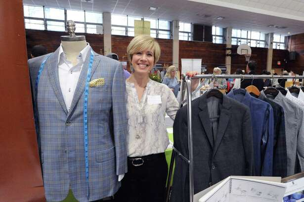 "Independent Personal Stylist, Nancy Carr, with J. Hilburn Custom Menswear during the Greenwich Chamber of Commerce Business & Culinary Showcase at the Civic Center in Old Greenwich, Conn., Thursday night, April 28, 2016. The event is billed as the ""largest business networking event of the year,"" by the Greenwich Chamber of Commerce. Seventy-five businesses had representatives that attended."