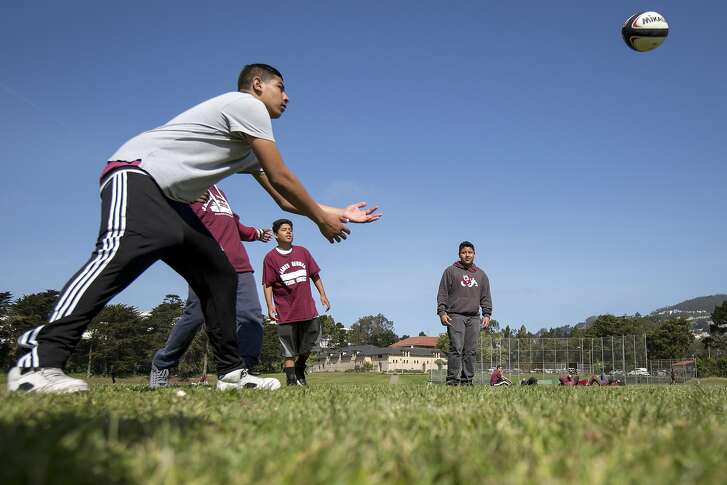James Denman Middle School 8th graders play rugby at Balboa Park on Friday, April 29, 2016 in San Francisco, Calif. Prop B would provide $3 million a year for parks from the city's general fund.