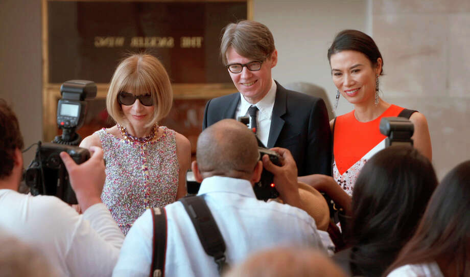 """This image released by Magnolia Pictures shows, from left, Anna Wintour, from left, Andrew Bolton and Wendi Deng in a scene from """"The First Monday in May."""" (Magnolia Pictures via AP) ORG XMIT: NYET453 / Magnolia Pictures"""