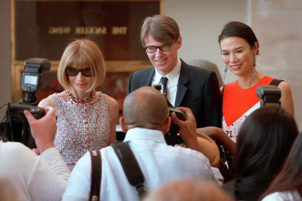 """This image released by Magnolia Pictures shows, from left, Anna Wintour, from left, Andrew Bolton and Wendi Deng in a scene from """"The First Monday in May."""" (Magnolia Pictures via AP) ORG XMIT: NYET453"""