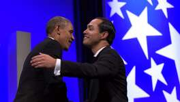 President Barack Obama, left, hugs Housing and Urban Development Secretary Julian Castro, right, as he arrives to speaks at the Congressional Hispanic Caucus Institute's (CHCI) 38th Anniversary Awards Gala in Washington, Thursday, Oct. 8, 2015. The Awards Gala is the signature event in its Hispanic Heritage Month list of events that include the Public Policy Conference. (AP Photo/Susan Walsh)