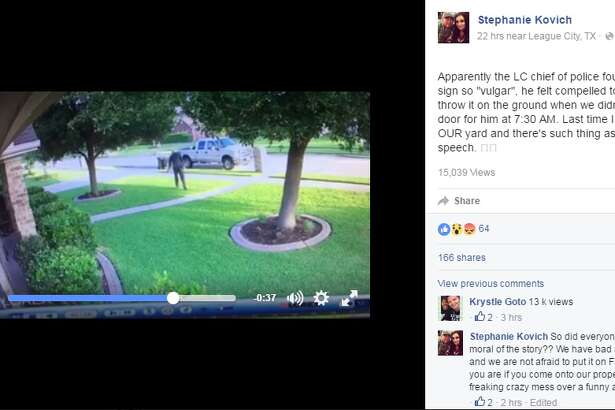 A screen grab of League City Stephanie Kovich's home surveillance footage where League City Police Chief Michael Kramm removes their yard sign that had a swear word on it.