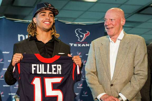 Houston Texans top draft pick, Notre Dame wide receiver Will Fuller, left, stands with owner Bob McNair as he shows off his new Texans jersey during a news conference at NRG Stadium on Friday, April 29, 2016, in Houston.