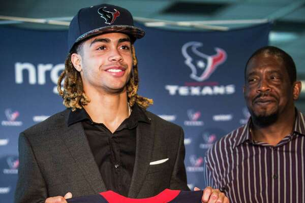 Houston Texans top draft pick, Notre Dame wide receiver Will Fuller, left, stands with his father, William Fuller, as he shows off his new Texans jersey during a news conference at NRG Stadium on Friday, April 29, 2016, in Houston.