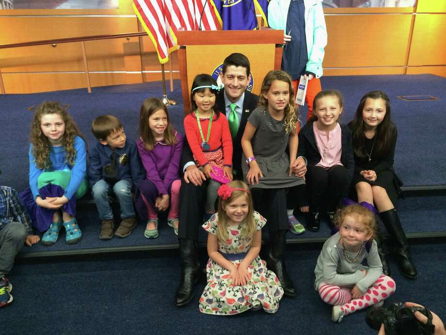 House Speaker Paul Ryan of Wis. sits with children during  take your children to work day, Thursday, April 28, 2016, on Capitol Hill in Washington. (AP Photo/Mary Clare Jalonick) ORG XMIT: DCMJ101 Photo: Mary Clare Jalonick / AP