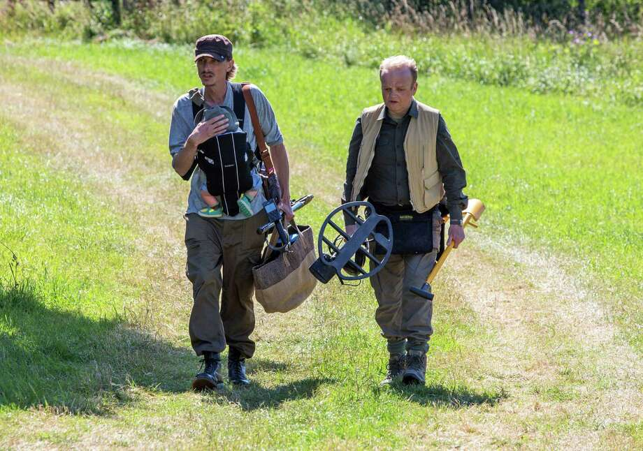 "This image released by Acorn TV shows Macenzie Crook, left, and Toby Jones in a scene from ""Detectorists."" Crook, who starred in ""Pirates of the Caribbean,"" films and ""Game of Thrones,"" writes, directs and stars in this TV series. (Acorn TV via AP) ORG XMIT: NYET434 / Acorn TV"
