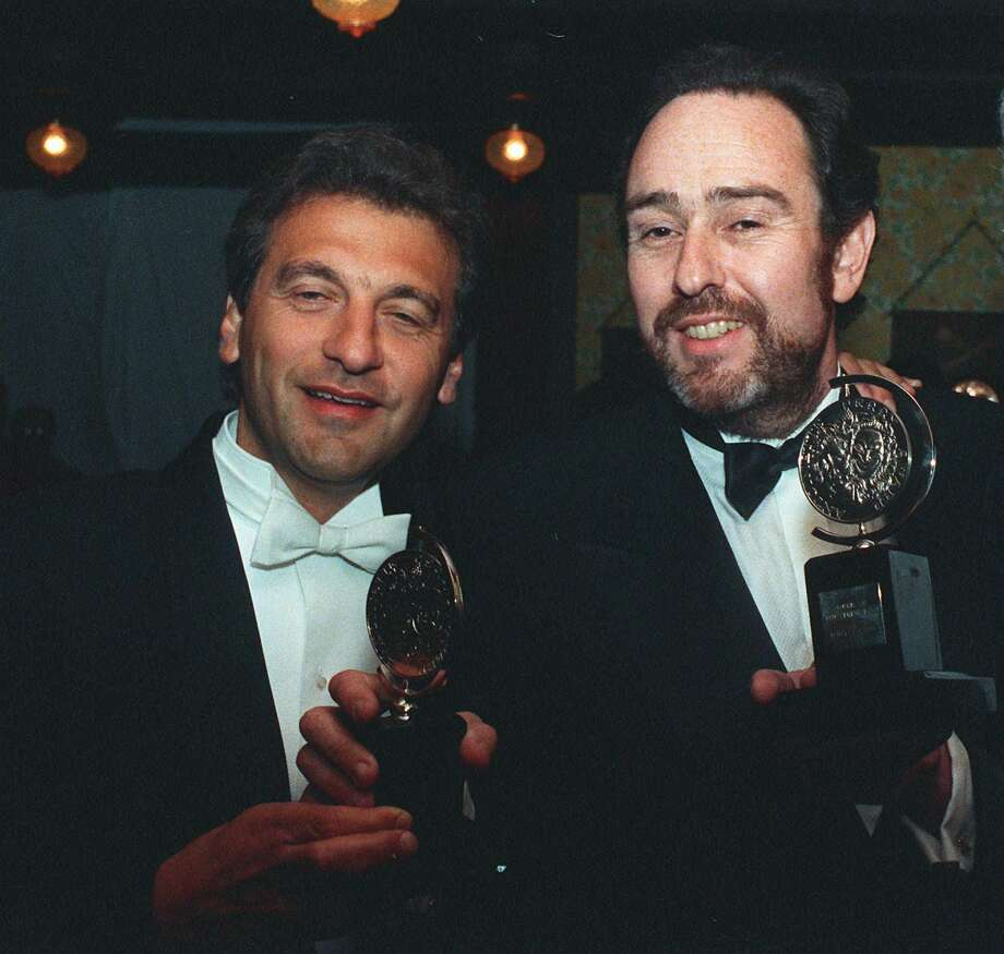 """FILE - In this June 8, 1987 file photo, Alain Boublil, left, and Claude-Michel Schonberg, the French creators of """"Les Miserables"""" hold two of the eight Tony awards won by the musical in New York. The duo are being celebrated Monday, May 2, 2016, with a star-filled concert at The New York Pops. (AP Photo/Ed Bailey, File) ORG XMIT: NYET431 Photo: ED BAILEY / AP"""
