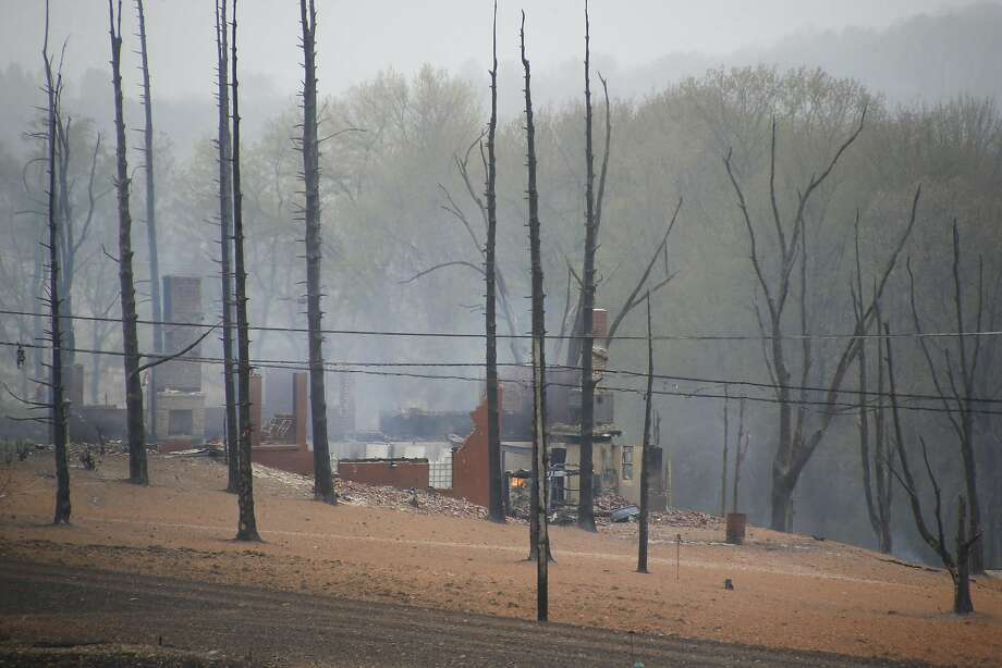 A burned-out house is surrounded by charred trees in the area where a natural gas pipeline exploded about 30 miles east of Pittsburgh. The cause of the blast is under investigation. Photo: Keith Srakocic, Associated Press