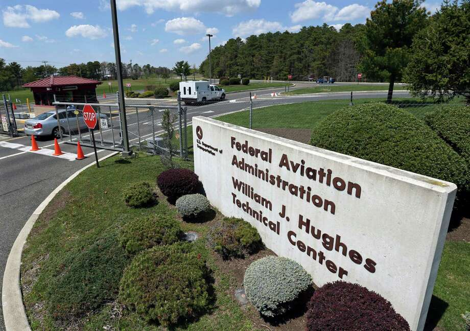 The controlled gate is seen at the Federal Aviation Administration's technical center near Atlantic City Tuesday, April 26, 2016, in Egg Harbor Township, N.J. The military is checking U.S. bases for potential groundwater contamination from a toxic firefighting foam, but only five states, including New Jersey, are actively monitoring for the chemicals used in the foam and spilled by other sources. New Jersey officials say they're focused on the Federal Aviation Administration's technical center near Atlantic City, where PFCs, known as perfluorinated compounds, have been found in groundwater and in low levels in municipal wells near the center's fire training area. (AP Photo/Mel Evans) ORG XMIT: NJME201 Photo: Mel Evans / Copyright 2016 The Associated Press. All rights reserved. This m