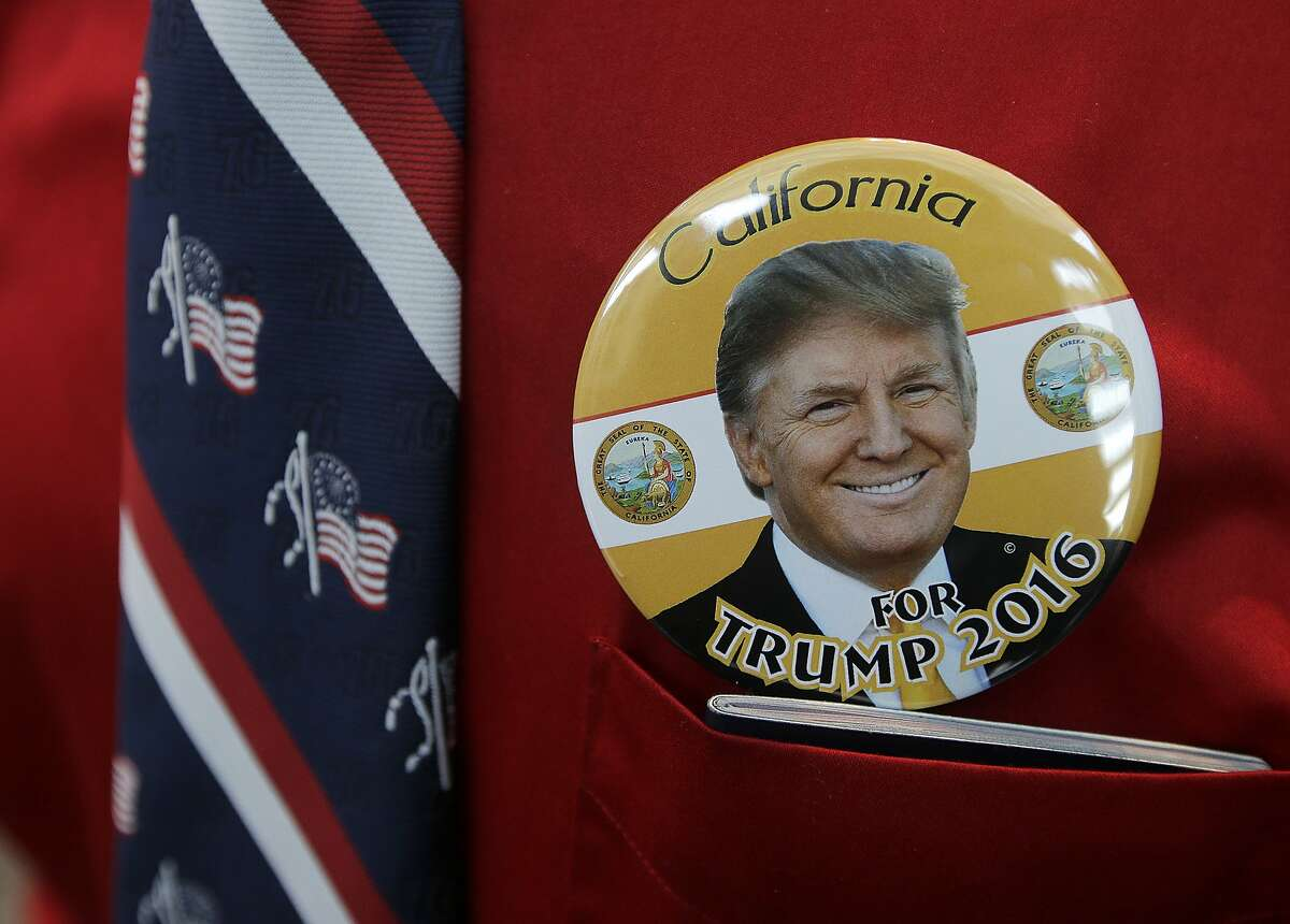 Donald Trump supporter Robert Tally wears a button of Trump before the California Republican Party 2016 Convention in Burlingame, Calif., Friday, April 29, 2016. (AP Photo/Jeff Chiu)