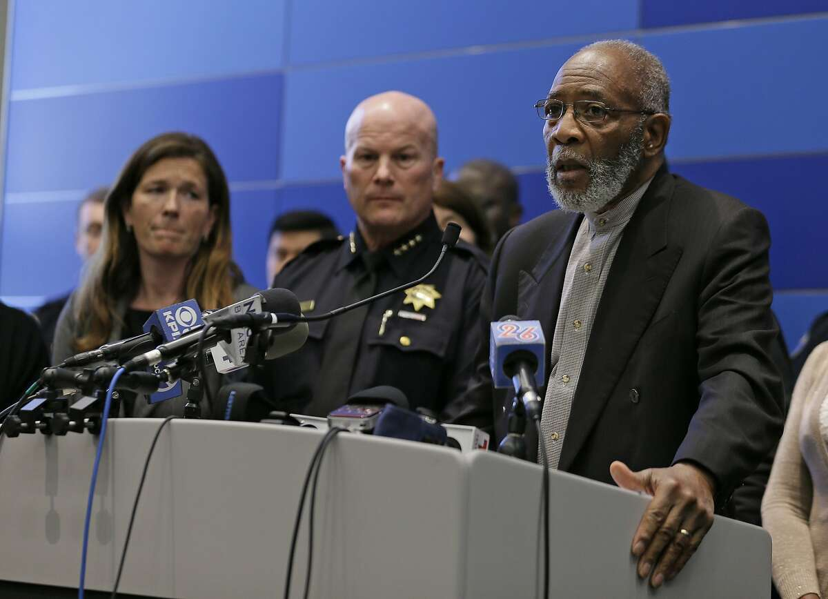 Rev. Amos Brown, right, of the NAACP, speaks as San Francisco Police Chief Greg Suhr, center, and Suzy Loftus, left, President of the San Francisco Police Commission, listen during a news conference Friday, April 29, 2016, in San Francisco. Suhr ordered that all officers attend an anti-harassment class, as he released more transcripts of a former lieutenant and two former officers exchanging racist text messages. (AP Photo/Eric Risberg)