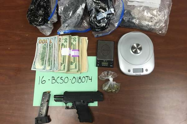 Black tar heroin, gun and cash recovered from April 26, 2016 in the 4400 block of Horizon Hill.