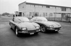 Lamborghini Factory; Sant' Agata, February 1966. The new Lamborghini 400GT 2+2, with four separate headlamps, is introduced to the Press alongside the prior 350GT model, which had followed the 350GTV.  (Photo by Klemantaski Collection/Getty Images)