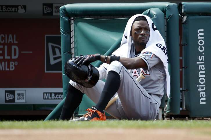 FILE - In this Aug. 30, 2015 file photo, Miami Marlins second baseman Dee Gordon (9) sits on the edge of the dugout during a baseball game against the Washington Nationals at Nationals Park, in Washington. Reigning NL batting champion Dee Gordon of the Miami Marlins says he unknowingly took the performance-enhancing drug that led to his 80-game suspension.  The startling announcement of the suspension by Major League Baseball came shortly after the Marlins� victory at Los Angeles on Thursday night, April 28, 2016.(AP Photo/Alex Brandon, File)