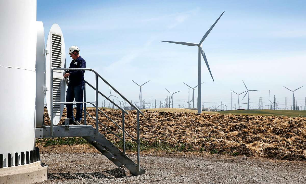 Larry Wilson, manager of the Iberdrola Renewables Shilo wind power farm, opens the hatch to an 80-meter high tower at the base of a wind turbine in Birds Landing, Calif. on Friday, April 29, 2016. The San Francisco PUC's CleanPowerSF program goes fully operational in May.