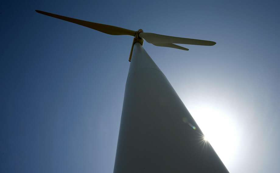 An 80-meter high wind turbine generates energy in Birds Landing. Photo: Paul Chinn, The Chronicle