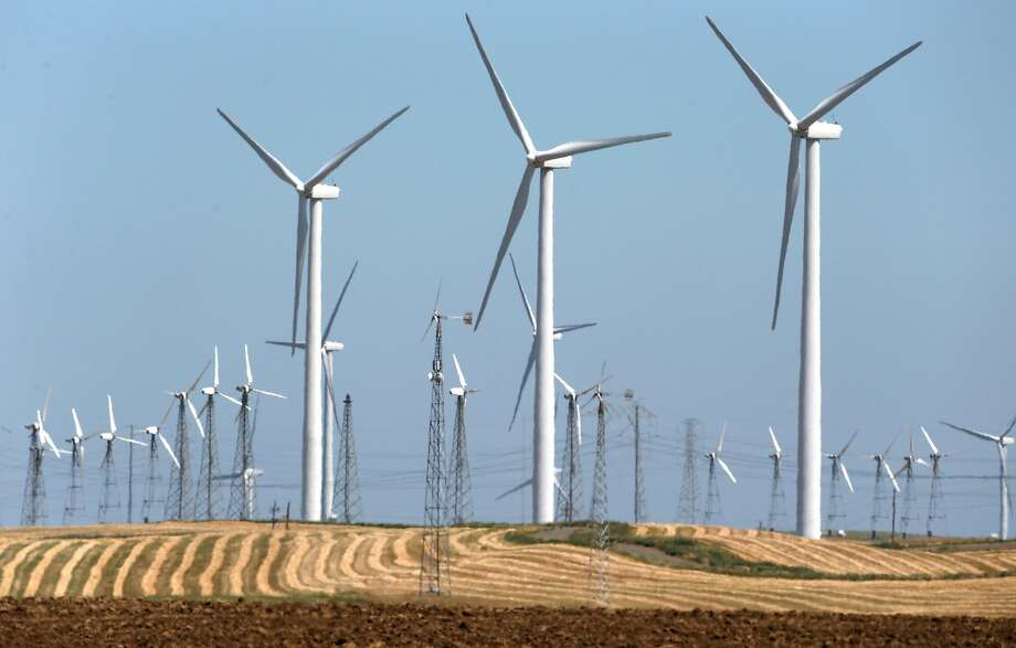 Wind turbines generate power in and around the Iberdrola Renewables Shilo wind power farm in Birds Landing, Calif. on Friday, April 29, 2016. The San Francisco PUC's CleanPowerSF program goes fully operational in May. Photo: Paul Chinn / The Chronicle