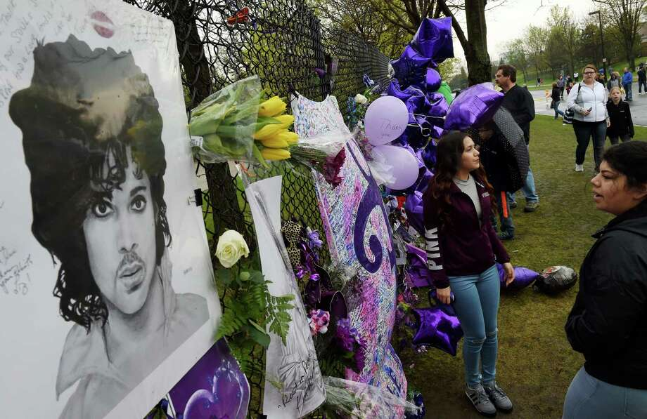 Fans gather  at a memorial wall outside the Paisley Park compound of music legend Prince. With Prince as his launching point, a reader discusses geniuses and   where they were nurtured. Photo: Mark Ralston / AFP / Getty Images / AFP or licensors