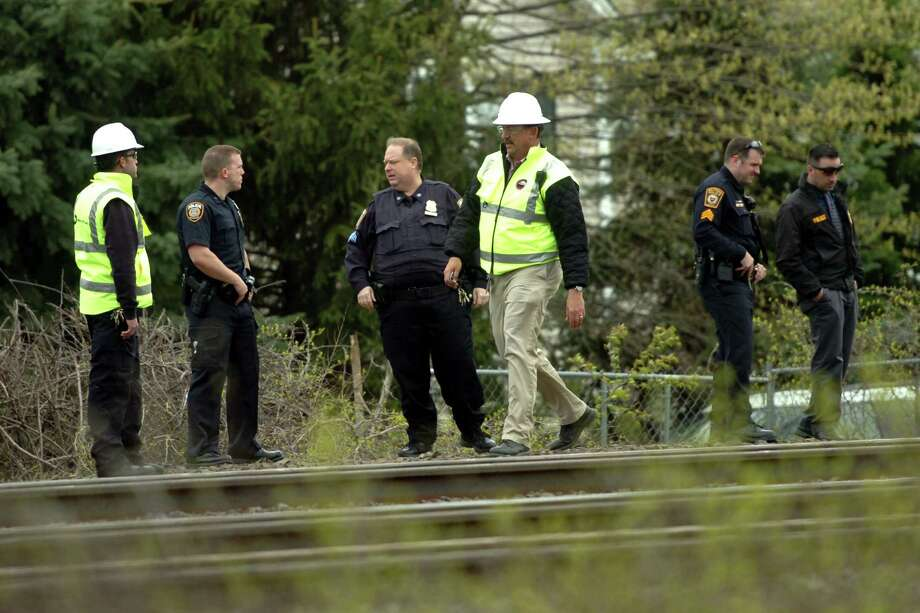 Milford and MTA police as well as Metro-North officials investigate at the scene of a pedestrian killed on the tracks by an Amtrak train by Buckingham Avenue and Gulf Street in Milford, Conn., on Friday Apr. 29, 2016. Photo: Christian Abraham / Christian Abraham / Connecticut Post