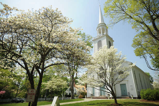 The dogwoods are in full bloom outside the Greenfield Hill Congregational Church in the Greenfield Hill section of Fairfield in this file photo. This year's Dogwood Festival is slated for Mother's Day weekend, May 6-8.