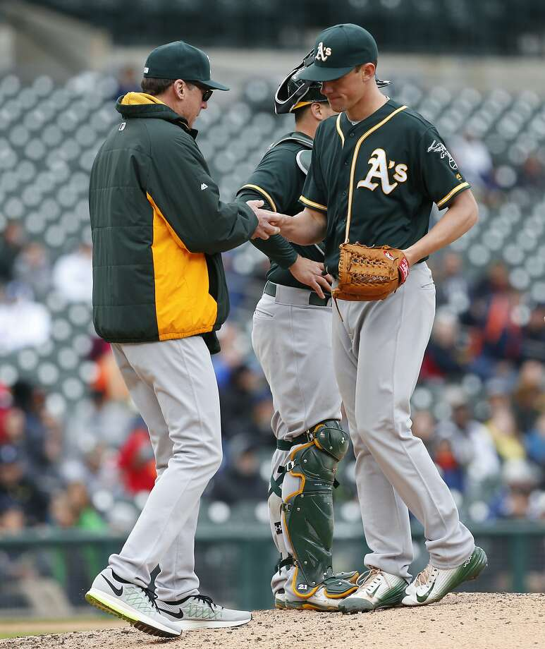 A's manager Bob Melvin takes the ball from Chris Bassitt in the fourth inning of Thursday's game in Detroit. On Friday, Bassitt was put on the 15-day disabled list. Photo: Paul Sancya, Associated Press