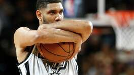 Spurs' Tim Duncan goes through his pre-tipoff routine before the game against the Memphis Grizzlies at the AT&T Center on March. 25, 2016.
